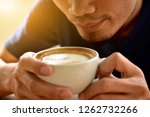 people are drinking latte... | Shutterstock . vector #1262732266