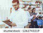 pharmacist writing something....   Shutterstock . vector #1262743219