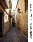 narrow street in the old city... | Shutterstock . vector #1262744599
