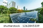 solar panel plant with urban... | Shutterstock . vector #1262845339