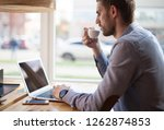 young male freelancer chatting... | Shutterstock . vector #1262874853