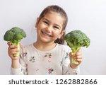 happy smiling child girl eating ...   Shutterstock . vector #1262882866