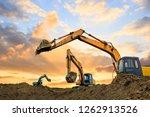 three excavators work on... | Shutterstock . vector #1262913526