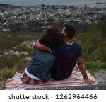 couple sitting on top of hill... | Shutterstock . vector #1262964466
