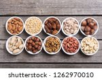 mix of nuts   pistachios ... | Shutterstock . vector #1262970010