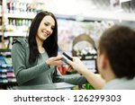 paying credit card for purchases | Shutterstock . vector #126299303