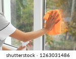 young chambermaid cleaning... | Shutterstock . vector #1263031486