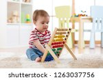 baby boy playing with an abacus ... | Shutterstock . vector #1263037756