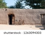 A Mud House In The Village Of...