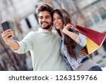 happy couple taking selfie... | Shutterstock . vector #1263159766