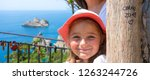 smiling little girl with hat by ... | Shutterstock . vector #1263244726