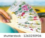 woman with hand fan lying on... | Shutterstock . vector #1263250936