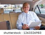 mature businessman working on... | Shutterstock . vector #1263326983