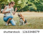 portrait of woman with her pets ... | Shutterstock . vector #1263348079