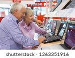 mature couple shopping for... | Shutterstock . vector #1263351916