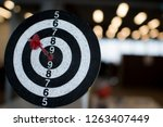 dart board hanging with red... | Shutterstock . vector #1263407449