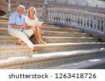 senior tourist couple on city... | Shutterstock . vector #1263418726
