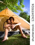 young smiling couple in tent on ... | Shutterstock . vector #1263455026