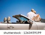 mature couple on coastal road... | Shutterstock . vector #1263459199