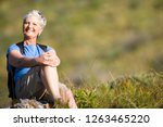 Mature Woman Resting On Hiking...