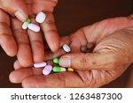closeup at elderly man hand... | Shutterstock . vector #1263487300