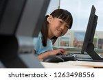 female elementary student... | Shutterstock . vector #1263498556
