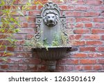 A Cast Stone Wall Planter With...
