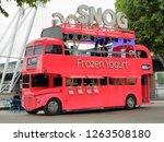 Small photo of Snog Frozen Yogurt double decker bus restaurant on the Queen's Walk along the south bank of River Thames, London, England, United Kingdom - June 23, 2018