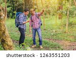hiking men with backpack travel ... | Shutterstock . vector #1263551203