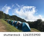 camping on mountain with blue... | Shutterstock . vector #1263553900