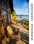 chairs sit on a cottage wooden... | Shutterstock . vector #1263612640