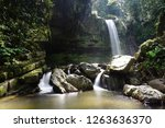 mahua waterfall is a plunge... | Shutterstock . vector #1263636370