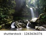 mahua waterfall is a plunge... | Shutterstock . vector #1263636376