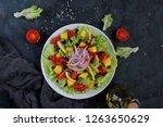 fresh salad with lettuce  mango ... | Shutterstock . vector #1263650629