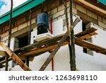 worker placing styrofoam sheet | Shutterstock . vector #1263698110
