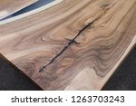 table of walnut in the style of ... | Shutterstock . vector #1263703243