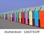 Row Of Colored Beach Huts With...