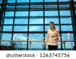 woman smiling waiting her... | Shutterstock . vector #1263745756