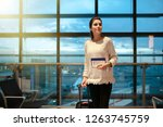 woman smiling waiting her... | Shutterstock . vector #1263745759