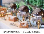 chrome plated bowls with golden ... | Shutterstock . vector #1263765583