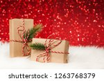 christmas gifts on wooden table ... | Shutterstock . vector #1263768379