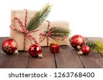 christmas gifts on wooden table ... | Shutterstock . vector #1263768400
