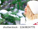 pretty woman in a winter forest ... | Shutterstock . vector #1263824770