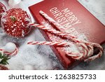 christmas gift box  candy cane... | Shutterstock . vector #1263825733