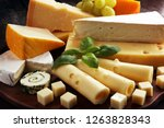 cheese plate served with grapes ... | Shutterstock . vector #1263828343
