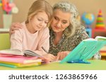 portrait of grandmother and... | Shutterstock . vector #1263865966