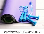 dumbbells and jump rope in cyan ... | Shutterstock . vector #1263922879