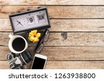 a cup of coffee with smartphone ...   Shutterstock . vector #1263938800