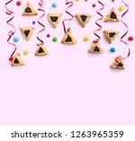 triangular cookies with poppy...   Shutterstock . vector #1263965359