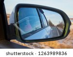 side mirror of the car and the... | Shutterstock . vector #1263989836